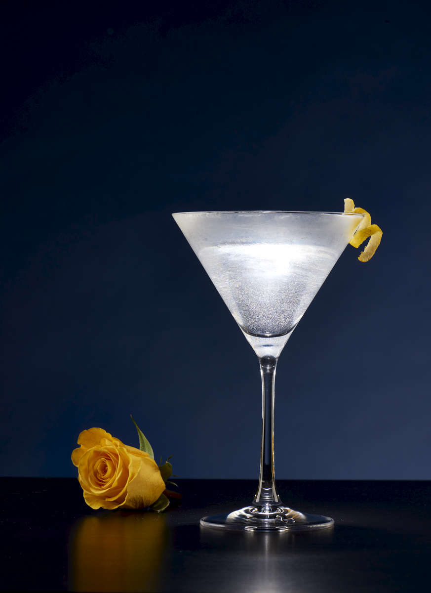 The Vesper Martini made famous by Author Ian Fleming.  Three parts Gin, One part Vodka and a splash of Lellet....and of course, shaken, not stirred.
