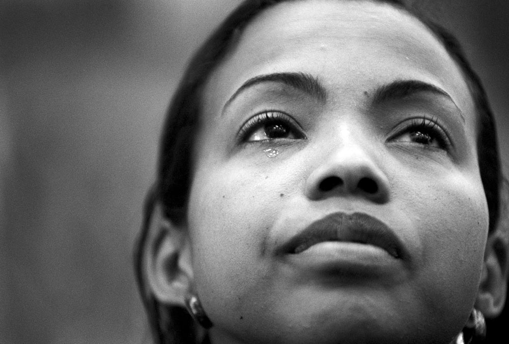 A tear falls from Sharon Booker's eye during a memorial service for her husband, Sean.  He was killed on September, 11, 2001 at The World Trade Center, NYC.