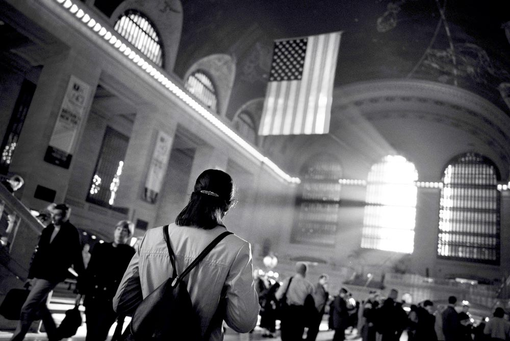 Sharon, who lives in Newark, NJ, walks through Grand Central Station Terminal in NYC on her way to work inside the MetLife building. Reminders of the attacks including patriotic displays are everywhere.