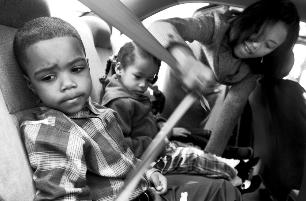 Sharon now has to raise her three children without their father. She buckles her kids into the back seat of the car for a trip to church. Sean, the eldest at age 5 says he misses his father.