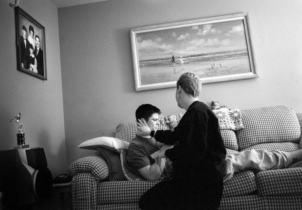 Lois Diehl of Brick, NJ, who lost her husband Michael in the attacks consoles her eldest son Jason.  {quote}I wish I could pick him up and hug him like when he was a kid.{quote} Lois says.