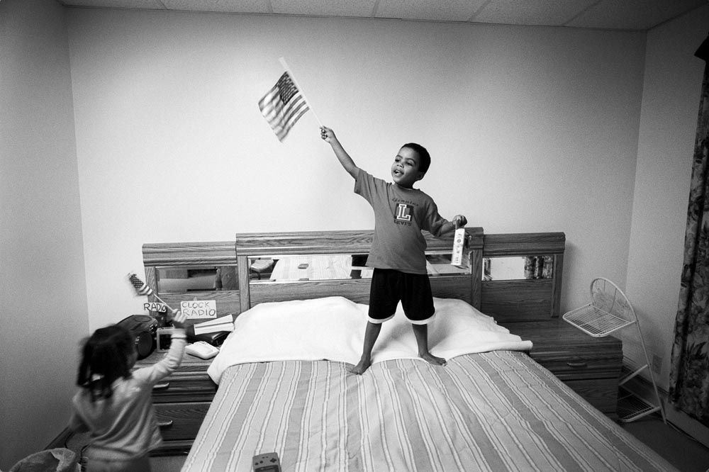 Sometimes life is almost normal. Little Sean and his younger sister wave American Flags in Sharon's bedroom. It's been two months since the attacks.