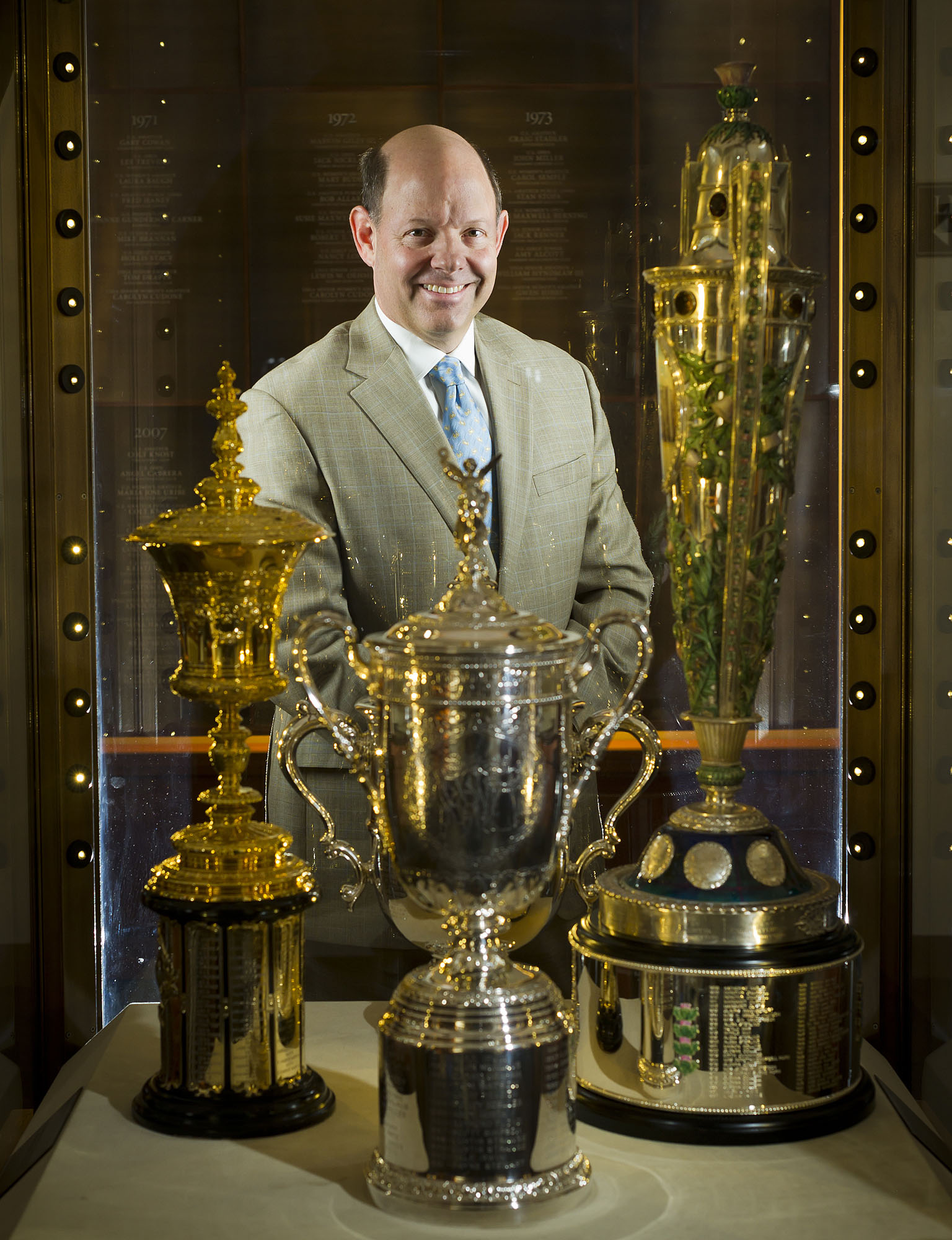 Mike Davis with USGA Trophies inside the Hall of Champions on the campus of the USGA (United State Golf Association).  Photographed for Meto Golf Association