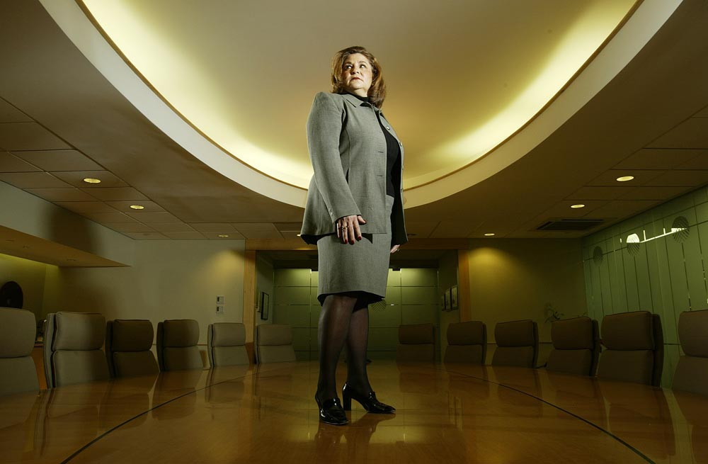 Annette Catino, President and CEO of QualCare Inc. of Piscataway poses in the company's conference room , on the table.   Photographed for The Star-Ledger