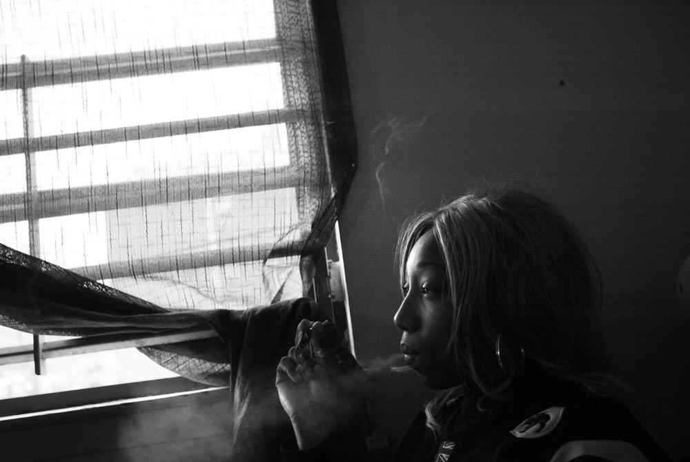 After school, Ayisha gets high on Ecstacy and pot at home.