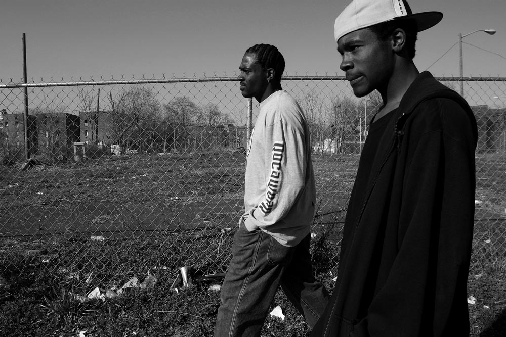 Al-Malik Collins, who lives in East Orange spends his day at home, out on the basketball court and with his dad, Al-Malik Wrenn.  Al-Malik is a CRIP.  Al-Malik and his dad walk along William St. near their home.   Mr. Wrenn has spent much of his son's life in prison for various convictions.  He is out and now trying to re-connect with his son.  Mr. Wrenn is concerned that Al-Malik is falling deep into the gang life.