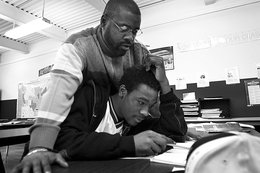 Teacher Tony Pendleton hovers over Al Malik Collins during a math lesson.  Pendleton takes a military approach to teaching.  Ron Orr, the school's principal refers to Pendleton as {quote}Colin Powell, the General.{quote}