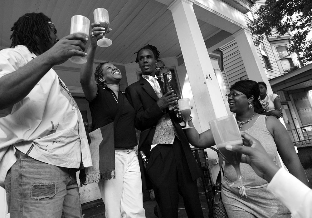 Tamar is toasted  as he prepares to leave his house to go to the prom by several members of the Valley School staff.  They toast him with sparkling grape cider.