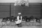 Ayisha sits alone on graduation day.  Later, she says that receiving her diploma made her feel  {quote}clean...you know, like I accomplished this. This is for the rest of my life.{quote}