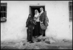 A family stands in the doorway of their home in the southeastern turkish city of Diyarbakir on a December morning.  The city, said to be the oldest in the world is unofficially known as the proxy capital of the Kurdish people. Turkey fears a possible attemp for Kurdish independence should the U.S. attack Iraq.