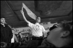 A young man holds up an PFLP flag at a rally in a cinema in Damascus, Syria.