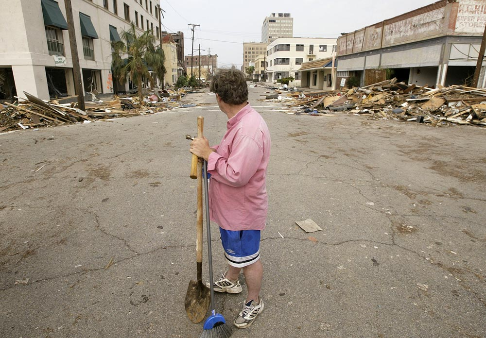 Gulfport, MS resident and business owner Eric Barthelemy stands on 14th St. in Gulfport with a shovel and broom before heading down the street to his french cafe to try to clean it up.  Scenes of devastation run along the entire coastline in Gulfport and Biloxi Mississippi Thursday following Hurricane Katrina. Photographed for The Star-Ledger