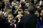 A young boy looks to his hand in awe after shaking it with U.S. President Barack Obama during a Newark, NJ campaign rally for NJ Governor Jon Corzine.  Photographed for The Star-Ledger