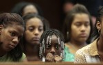 Kala Jenkins (age 9) (center), the daughter of murder victim {quote}Rocky{quote} Jenkins sits in Essex County Court  during the sentencing of her father's killer Edward Peoples. Seated with her are Medina Kenkins (left) a niece and Faja Jenkins (age 13) (left center behind), {quote}Rocky{quote} Jenkins other daugther. Edward Peoples of Newark, NJ is sentenced to 65 years in prison before Essex County Superior Court Judge Michael Ravin . In the court were the victim, {quote}Rocky{quote} Jenkins' family including his parents and his daughters. Edward Peoples tried everything to avoid a murder conviction, including spiriting his girlfriend out of state, going on the lam and convincing a friend to testify he wasn't there. Photographed for The Star-Ledger