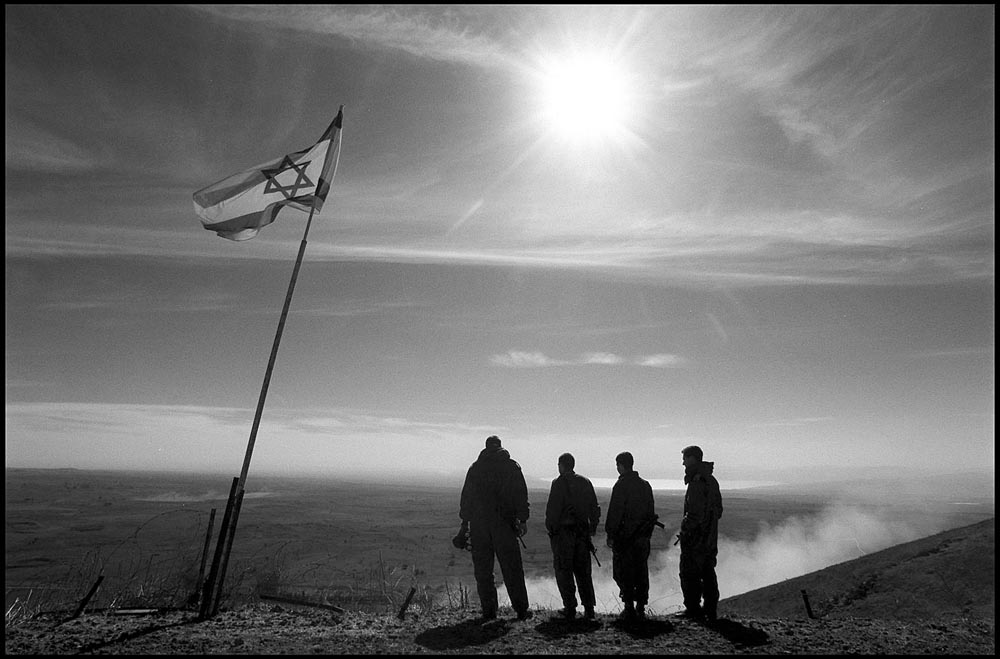 Israeli Soldiers watch wargames in the valley below an ancient volcano on the Golon. Photographed for The Star-Ledger