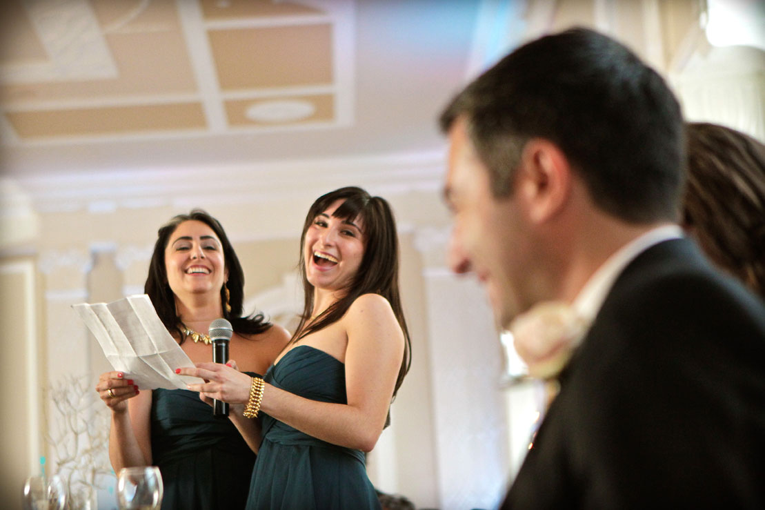 Two sisters laugh during a toast at a wedding reception at the Berkeley Hotel in Asbury Park, New Jersey