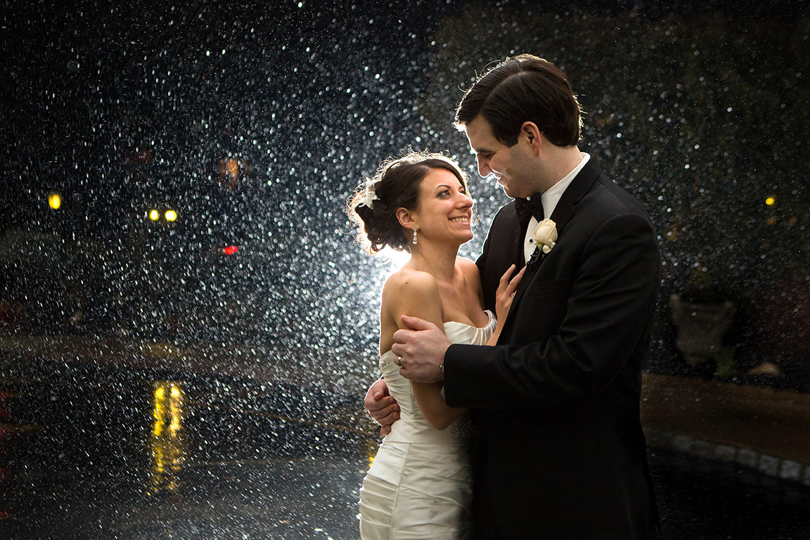 A portrait of a bride and groom on a rainy wedding day. The reception was held at the <u>Wilshire Grand</u></a> in West Orange, New Jersey.