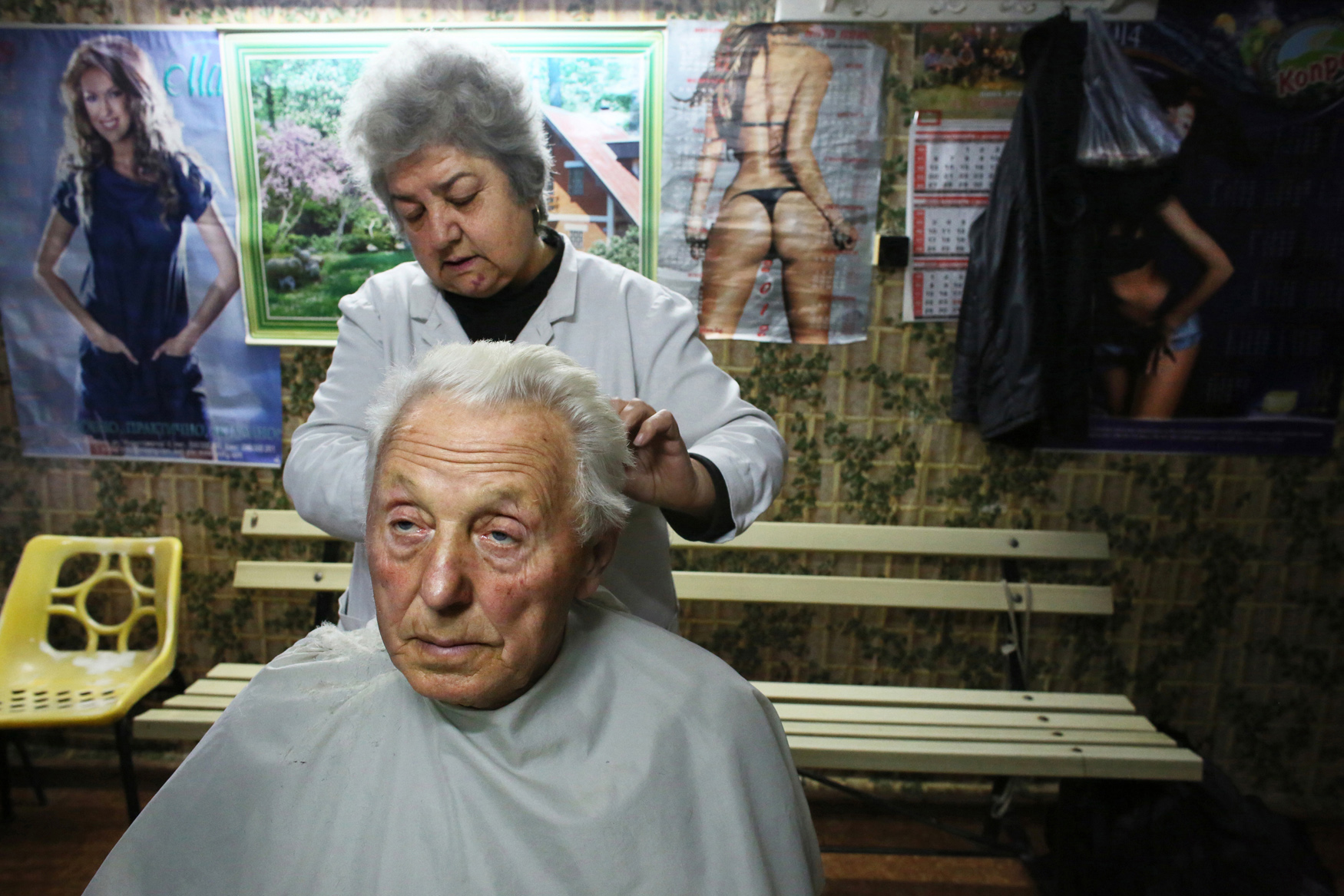Hair dresser Pavlinka Paskova, 59, cuts the hair of Stanko Petrov Vulchev, 80, in Vidin, Bulgaria, on October 30th, 2014. Paskova  says she has very few customers in this town of waning population: {quote}There's little hope of prosperity for the young here - they've all emigrated.{quote}Bulgaria has the most extreme population decline in the world — much due to post-1989 emigration, high death rates and low birth rates. There are so few people of child-bearing age in the nation that population statistics project a 30-percent decrease by 2060, from 7.2 million to just over 5 million. In other words, Bulgaria's population declines by 164 people a day, or 60,000 people a year — 60 percent of them aged over 65.