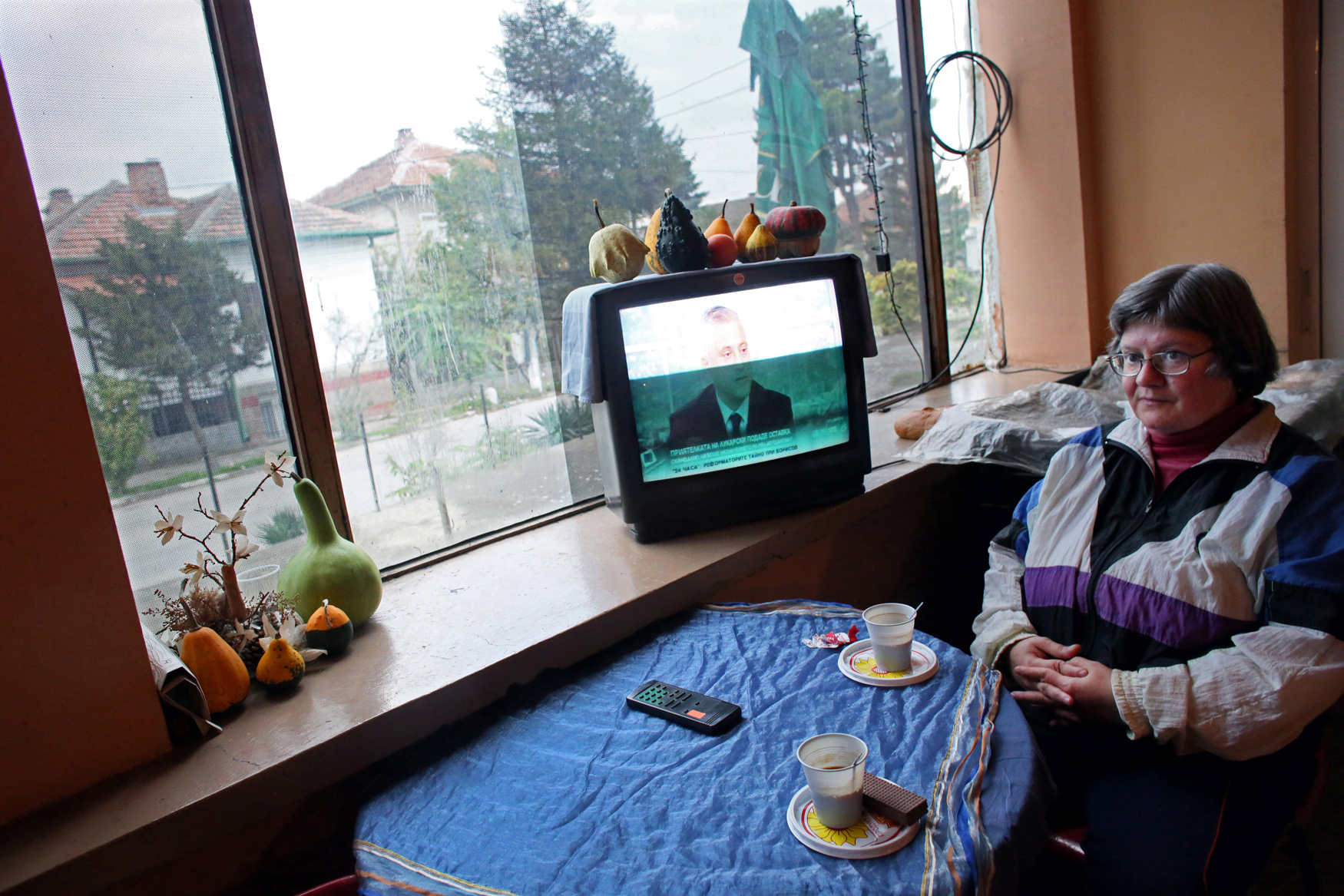 Veselka Vasileva gazes off into space as the TV drones on at a grocery store in Sinagovtsi, a village of rapidly declining population in Bulgaria, on October 22nd, 2014. Bulgaria has the most extreme population decline in the world — much of it due to post-1989 emigration, high death rates and low birth rates. There are so few people of child-bearing age in the nation that population statistics project a 30-percent decrease by 2060, from 7.2 million to just over 5 million. In other words, Bulgaria's population declines by 164 people a day, or 60,000 people a year — 60 percent of them aged over 65.