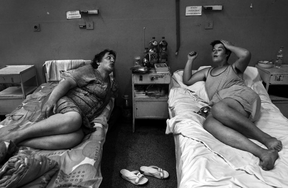 Female patients talk about their family lives and about dealing with manic depression in the psychiatry ward of a county hospital in Bulgaria on August 23, 2007.