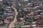 A road snakes through Kigali, Rwanda on November 19, 2017. The land-locked African nation relies on hydropower and wood-burning for its energy, emissions from which combine with automotive and bike exhaust to form a blanket of pollution. While Rwanda is making an effort to source more climate-friendly fuels, the country has already experienced temperature increases higher than the global average, which are projected to continue to rise by 2.5 degrees C from its 1970 temperatures, by the 2050s. Nearly half of all Rwandans live in poverty, relying on small-scale farming for survival without gas or electricity. With so many women and children spending hours of the day foraging for wood used for cooking and light, often damaging their eyes, lungs, the forests and atmosphere, a little inventiveness helps. Enter cow and enter pig — not just as a source of food, but also the heat needed to cook it. Or more specifically, their poo — the fuel fed to a biogas digester, a tank that coverts organic waste into methane. Photographs by: Yana Paskova