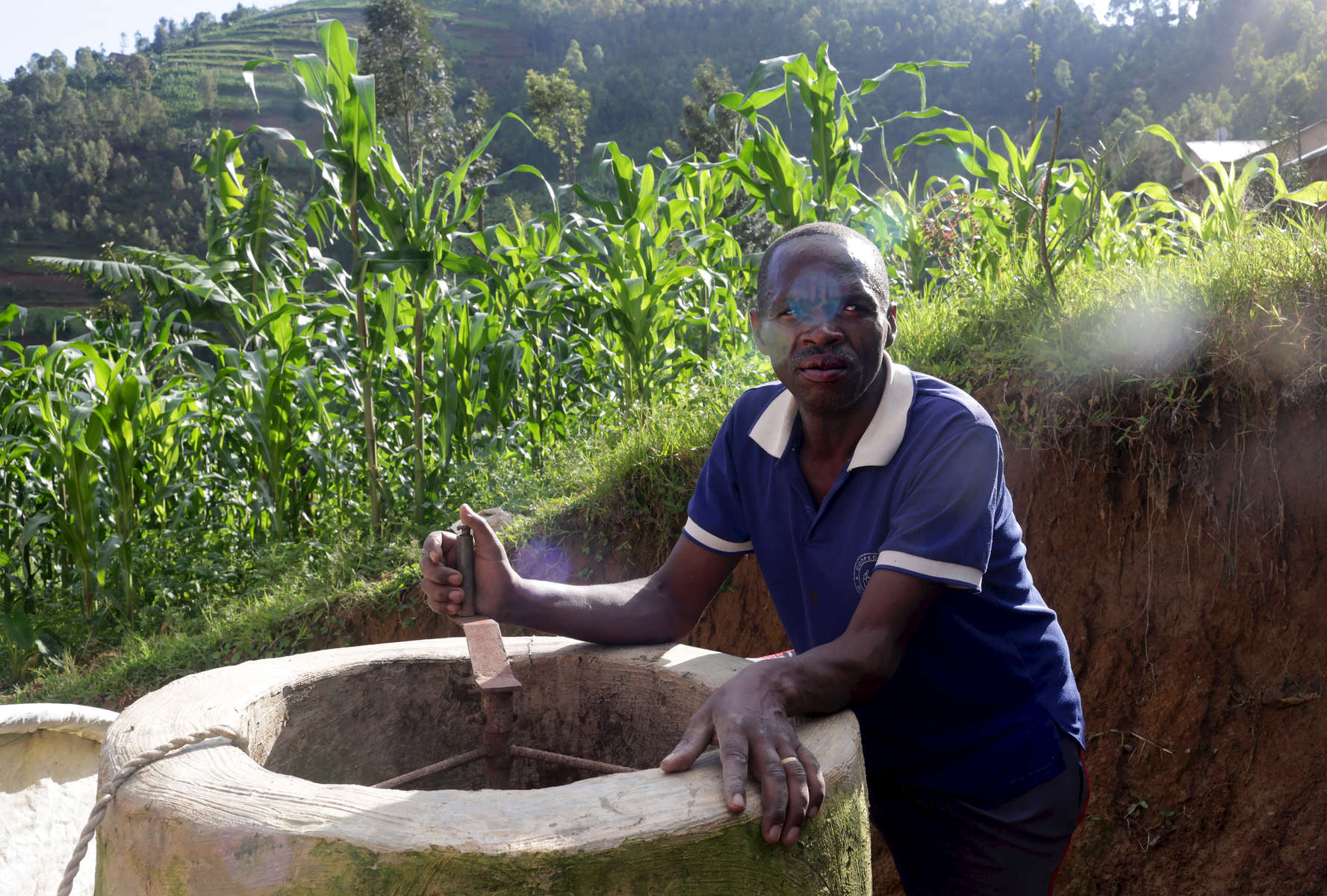 Etiene Twagirayezu, 60, talks about his biogas digester in front of his home in Rutabo, Rwanda, on November 18, 2017. Twagirayezu says that before his digester, he'd spend up to 3 hours a day gathering 10 kilograms of wood, and saw kids get injured climbing trees and be late to school doing the same. He added he was happy his workload at home was reduced due to being able to use his cow's and pig's poo instead of wood as fuel, as well as about the resulting lessening of deforestation. Nearly half of all Rwandans live in poverty, relying on small-scale farming for survival without gas or electricity. With so many women and children spending hours of the day foraging for wood used for cooking and light, often damaging their eyes, lungs, the forests and atmosphere, a little inventiveness helps. Enter cow and enter pig — not just as a source of food, but also the heat needed to cook it. Or more specifically, their poo — the fuel fed to a biogas digester, a tank that coverts organic waste into methane. Photographs by: Yana Paskova