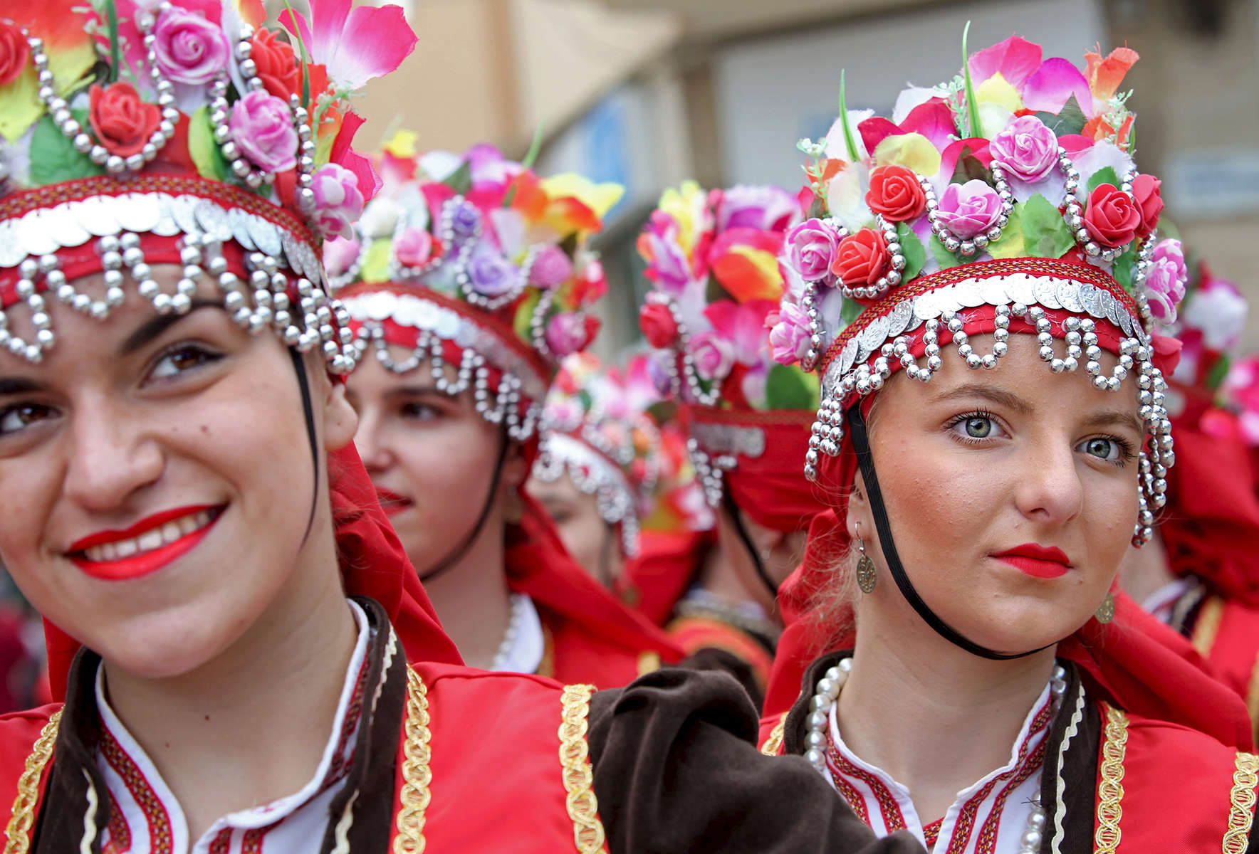 Members of the folk ensemble Kocani, from Kocani, Macedonia, prepare to perform on stage during an International Folklore Festival on June 02, 2018, which is a part of the Rose Festival in Kazanlak, Bulgaria. The festival, situated in the Rose Valley of Bulgaria, celebrated 115 years in 2018.  Photo by: Yana Paskova for National Geographic Traveler