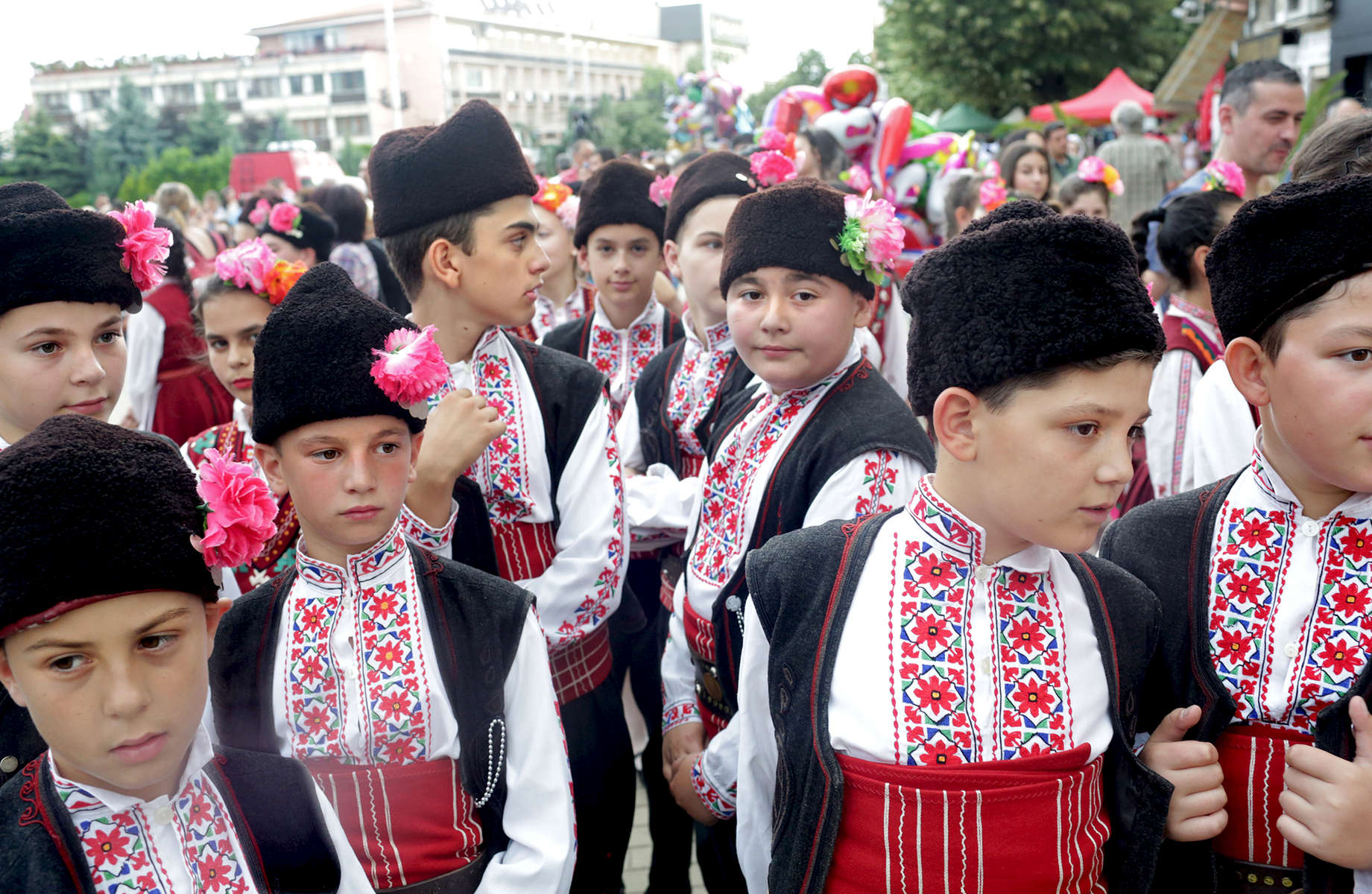 Members of the folk ensemble Iskra from Kazanlak, Bulgaria, prepare to perform on stage during an International Folklore Festival on June 02, 2018, which is a part of the Rose Festival in Kazanlak, Bulgaria. The festival, situated in the Rose Valley of Bulgaria, celebrated 115 years in 2018.  Photo by: Yana Paskova for National Geographic Traveler