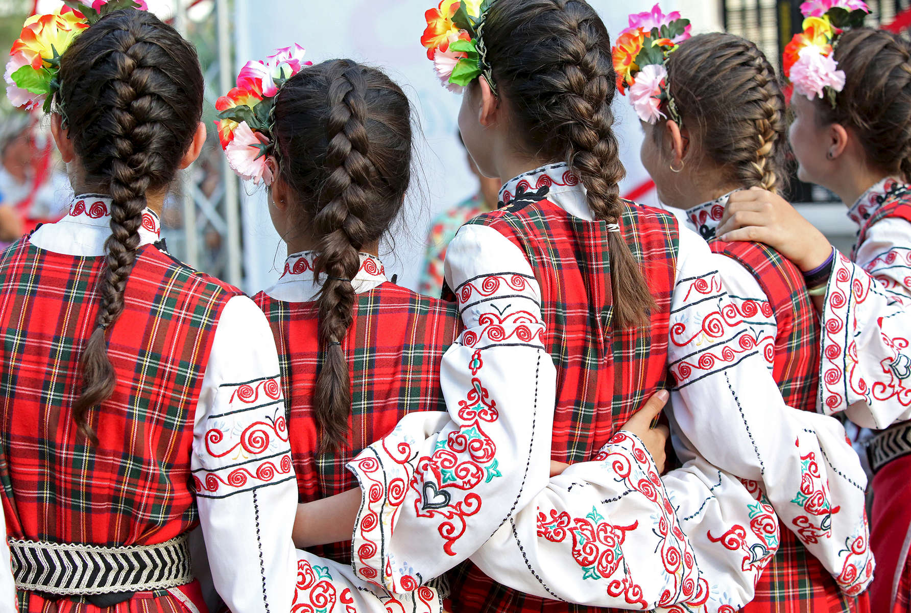 Members of the dance ensemble Arsenal, from Kazanlak, Bulgaria, prepare to dance on stage during an International Folklore Festival on June 02, 2018, the second day of the three-day Rose Festival in Kazanlak, a town situated in the Rose Valley of Bulgaria. The festival celebrated 115 years in 2018.  Photo by: Yana Paskova for National Geographic Traveler