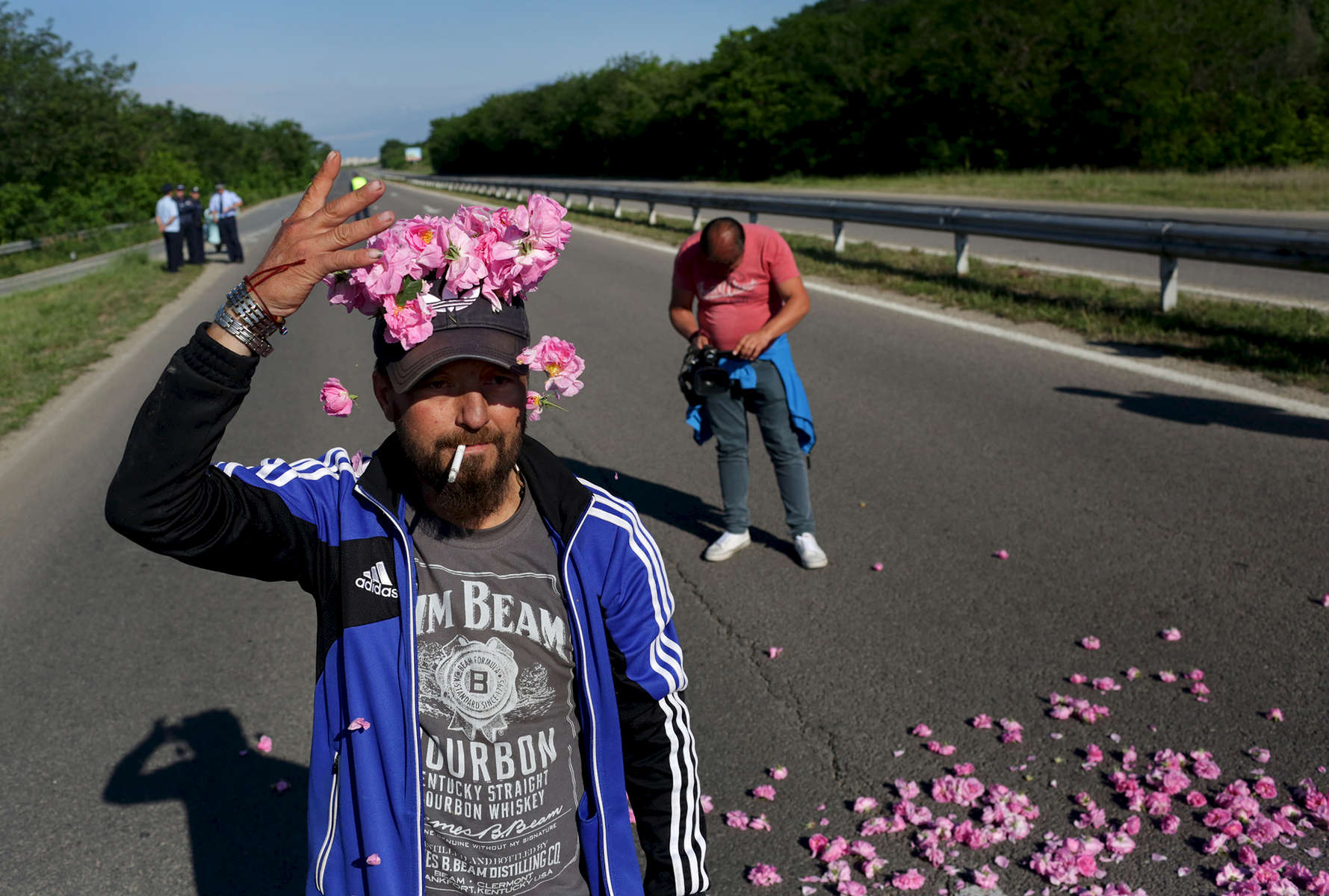 Rose producers from Kazanlak and surrounding towns and villages in Bulgaria's Rose Valley, stage a protest against the low purchase prices of rose flowers, on the road between Stara Zagora and Kazanlak on May 22, 2018. Producers say this year's rose purchase price has fallen from 3 to 5 leva BGN (currently about $1.80 to $3 USD) per kilogram in previous seasons, to just 2 leva BGN (currently about $1.20 USD) per kilogram - half of which they use to pay their rose-pickers, and use much of the rest for costs related to cultivating roses. Rose distilleries have refused to buy some of the producers' rose yield due to what they say is an inability to process any extra in an over-saturated market, with more and more rose gardens popping up each year. Some rose producers say they suspect the distilleries have instead colluded to lower the purchase prices of roses across the valley, and say they'd like the government to regulate the entire chain between producers and processors, setting a contractual minimum purchase price via a Rose Act. Bulgaria's Minister of Agriculture, Rumen Porozhanov, has announced he is indeed considering a law on oil-bearing roses - and perhaps other essential oil crops, like lavender.Photo by: Yana Paskova for National Geographic Traveler