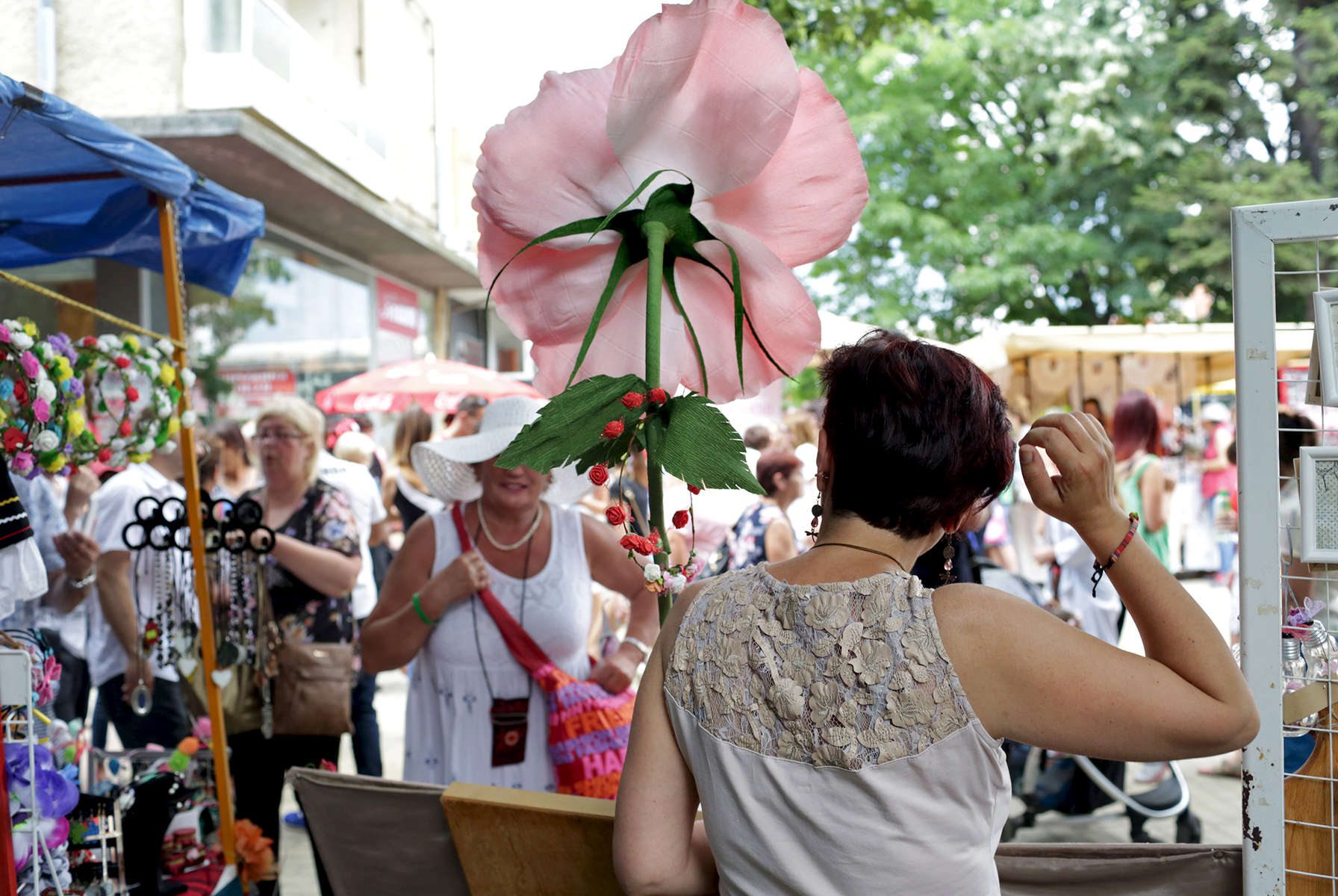 Crowds fill the town center lined with vendors selling rose merchandise after {quote}The Wisdom of the Rose{quote} parade, which is a part of the Rose Festival, on June 03, 2018 in Kazanlak, Bulgaria. The festival, situated in the Rose Valley of Bulgaria, celebrated 115 years in 2018. Photo by: Yana Paskova for National Geographic Traveler