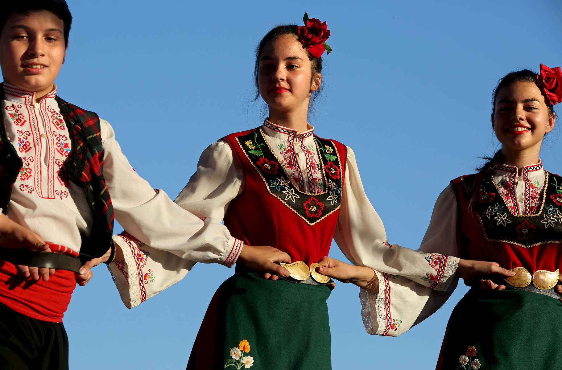 Members of the dance ensemble Zhar, from Kazanlak, Bulgaria, dance on stage during an International Folklore Festival on June 01, 2018, at the Rose Festival in Kazanlak, a town situated in the Rose Valley of Bulgaria. The festival celebrated 115 years in 2018.  Photo by: Yana Paskova for National Geographic Traveler