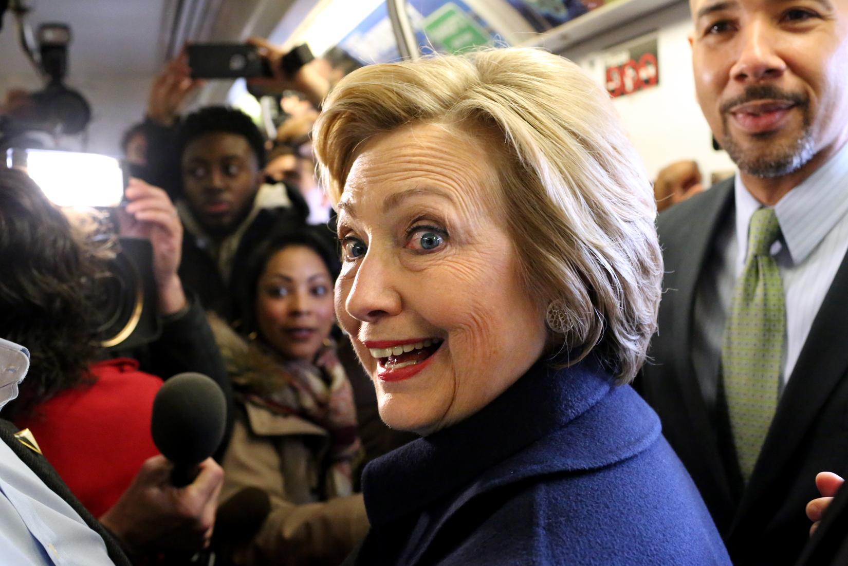 U.S. Presidential candidate Hillary Clinton (D-NY) and Bronx borough President Ruben Diaz Jr. ride the subway from the 161st Street to the 170th Street subway station in the Bronx, NY, on April 07, 2016.