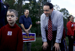 U.S. Presidential hopeful Mike Huckabee (R-AR) jokes around with five-year-old Luke Marks, from Tampa, Florida, by a polling site at the Westchase Swim and Tennis Center, where he stopped by to greet voters and potential supporters in Tampa, Florida, on the state's primary day, Tuesday, January 29, 2008.(For The New York Times)