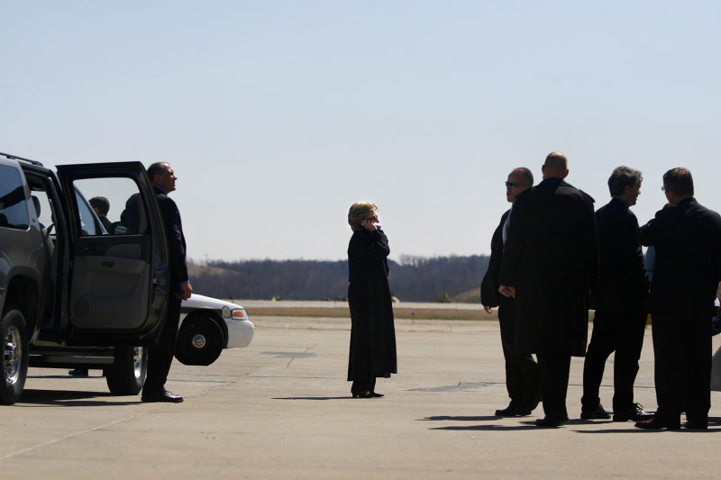 After a day of campaign stops, U.S. Presidential hopeful Hillary Clinton (D-NY) talks on the phone as she and her staff prepare to depart the Pittsburgh International Airport in Pittsburgh, Pennsylvania, to San Francisco, California, on Wednesday, April 02, 2008. The Senator is hoping to woo crucial to her votes in Pennsylvania before its primary on April 22, 2008.(For The New York Times)