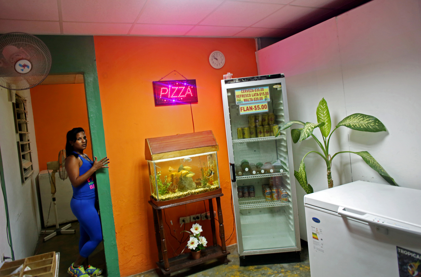 A girl takes orders in a late-night pizza joint, playing mostly American music from the 1980s and 1990s, in the port city of Mariel, Cuba, a town whose tranquil appearance belies its important place in both the history and future of Cuban-American interaction. It is where Russians unloaded nuclear warheads in the 1962 Cuban missile crisis, and the gateway through which 125,000 Miami-bound emigres fled during the Mariel Boatlift of 1980. The town is now the site of construction of a deepwater container port and a free-trade zone, a critical ingredient for which will be the future of the U.S. embargo against Cuba, in place for more than 50 years but now under speculation of being lifted.