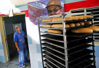 A bakery features a portrait of current president of Cuba Raúl Castro in the port city of Mariel, Cuba, a town whose tranquil appearance belies its important place in both the history and future of Cuban-American interaction. It is where Russians unloaded nuclear warheads in the 1962 Cuban missile crisis, and the gateway through which 125,000 Miami-bound emigres fled during the Mariel Boatlift of 1980. The town is now the site of construction of a deepwater container port and a free-trade zone, a critical ingredient for which will be the future of the U.S. embargo against Cuba, in place for more than 50 years but now under speculation of being lifted.
