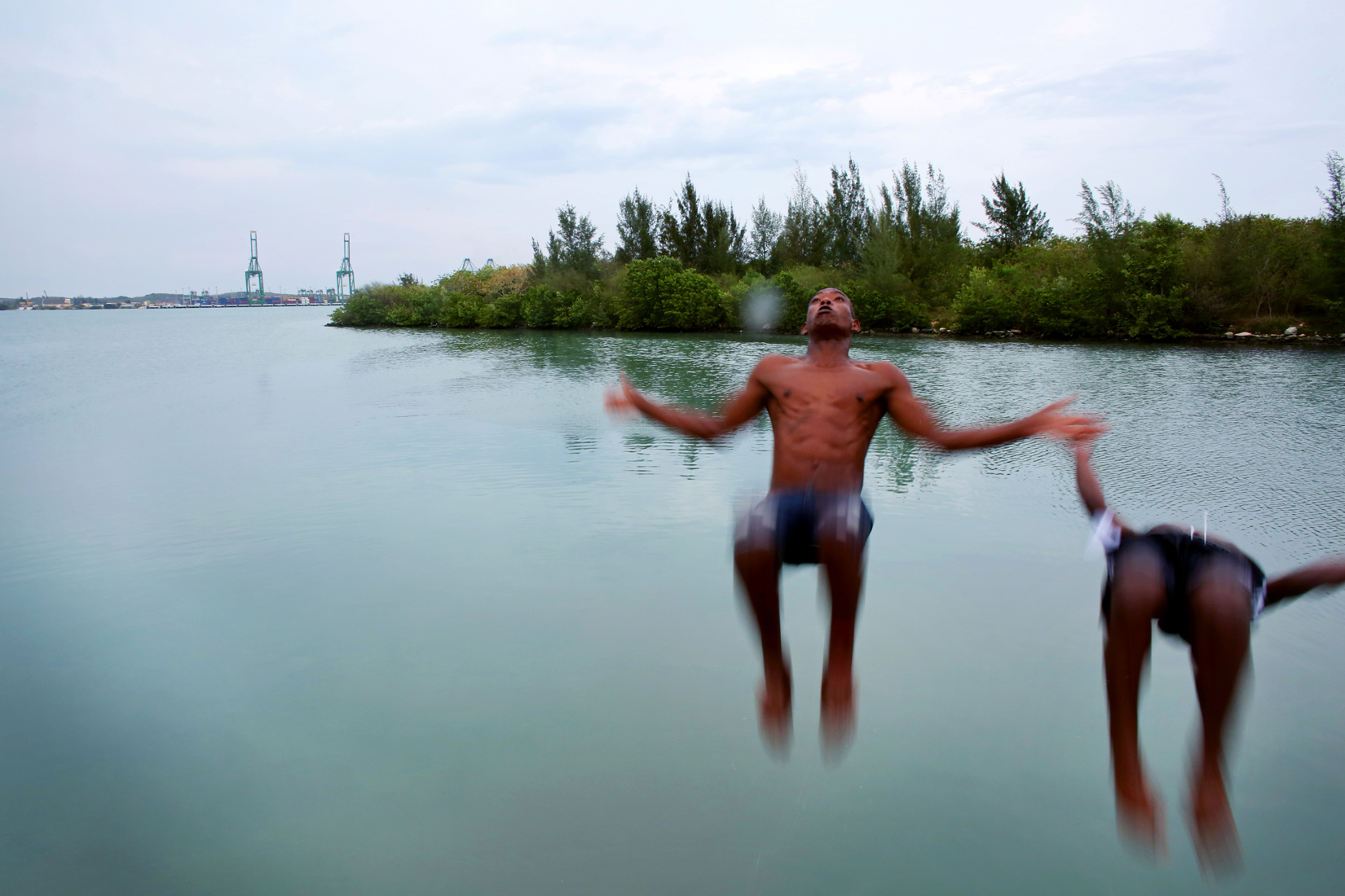 (L-R) Yandi Corrioso Samoraz, 22, and Raymel Medina, 16, go for an evening dip in the water, with construction of the new port visible in the background, in Mariel, Cuba. Raymel says he'd like to learn more about the world, but extremely limited internet access in his city, and in the country in general, makes this a challenge. (Internet access is either difficult to find, or prohibitively expensive.) Mariel's tranquil appearance belies its important place in both the history and future of Cuban-American interaction. It is where Russians unloaded nuclear warheads in the 1962 Cuban missile crisis, and the gateway through which 125,000 Miami-bound emigres fled during the Mariel Boatlift of 1980. The town is now the site of construction of a deepwater container port and a free-trade zone, a critical ingredient for which will be the future of the U.S. embargo against Cuba, in place for more than 50 years but now under speculation of being lifted.