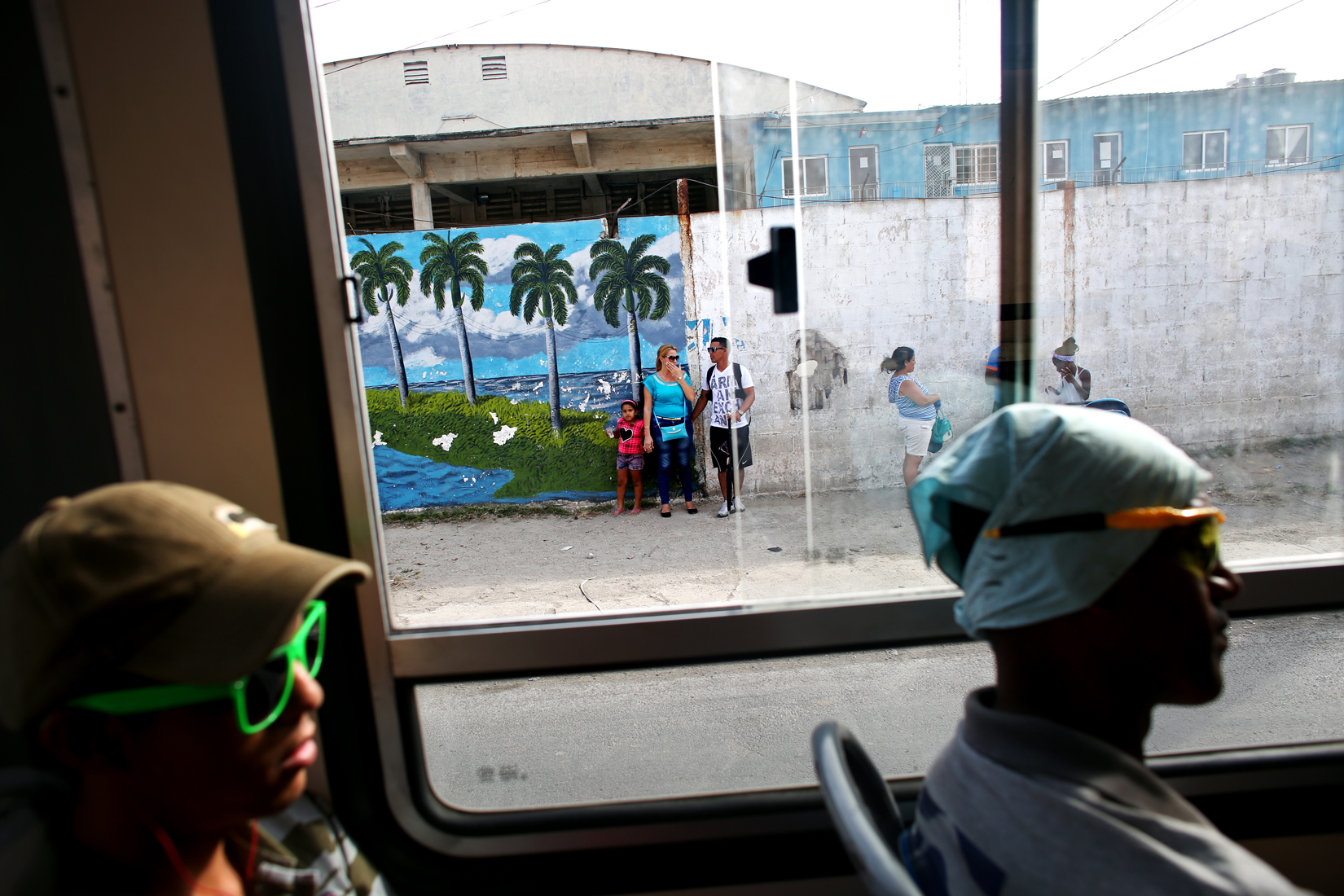 A bus transports its passengers to Mariel, a port city whose tranquil appearance belies its important place in both the history and future of Cuban-American interaction. Here is where the Russian navy unloaded its nuclear warheads in the 1962 Cuban missile crisis, as well as the site of the famous Mariel Boatlift of 1980, when 125,000 Miami-bound emigres fled the island during a 6-month lift on travel restrictions to the U.S.Now, Mariel's largest development project in history - a deepwater container port and a free-trade zone - aims to attract foreign investment, especially that of the U.S. A critical ingredient for its success will be the status of the U.S. embargo against Cuba, in place for more than 50 years, but now under speculation of being lifted.