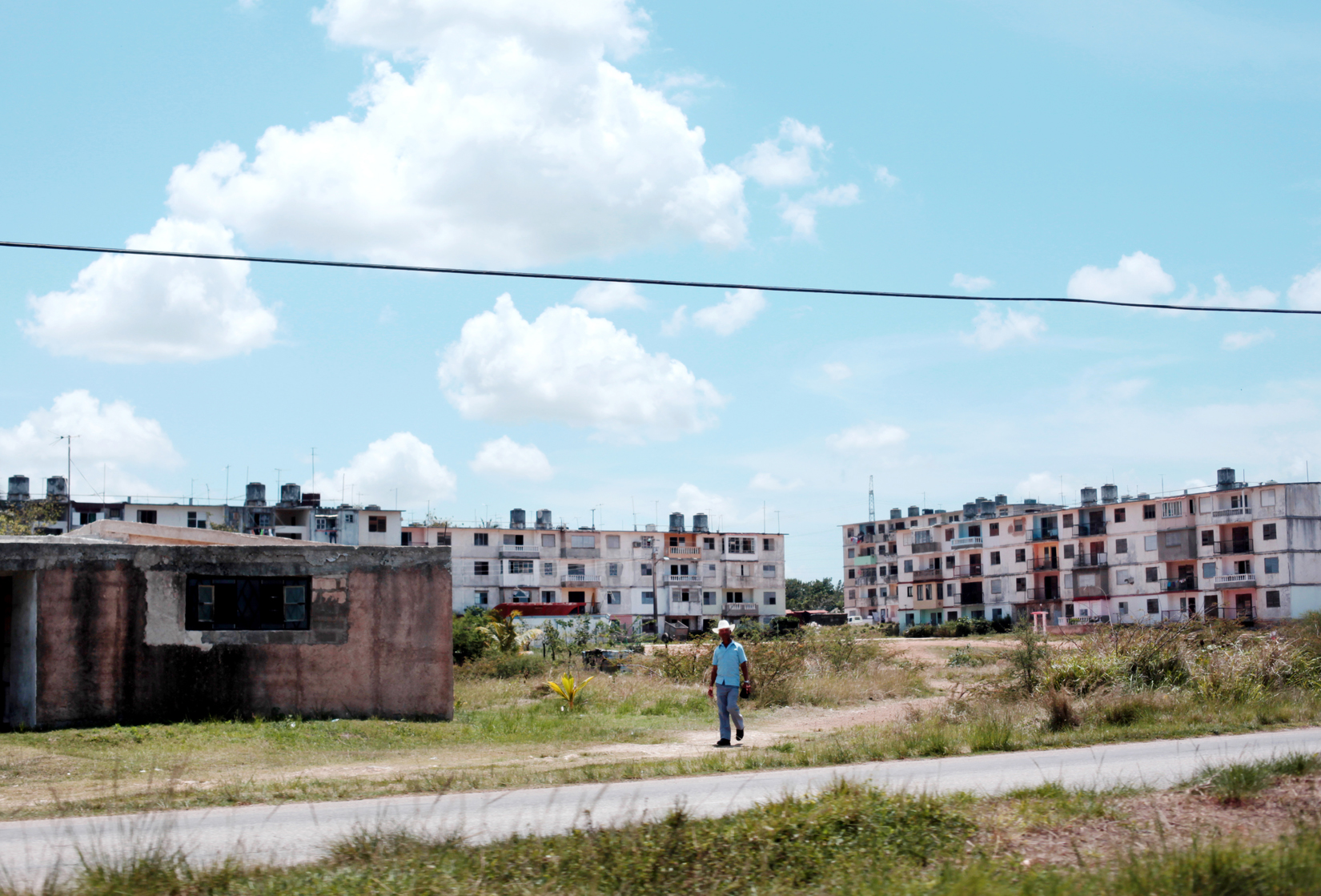 Apartment blocks with a crumbling infrastructure are seen in the provinces on the way to the port city of Mariel, Cuba, on April 19, 2015. Statistics label 7 out of every 10 Cuban houses in need of major repairs, with the province surrounding the capital requiring approximately 300,000 more inhabitable properties.Mariel's tranquil appearance belies its important place in both the history and future of Cuban-American interaction. It is where Russians unloaded nuclear warheads in the 1962 Cuban missile crisis, and the gateway through which 125,000 Miami-bound emigres fled during the Mariel Boatlift of 1980. The town is now the site of construction of a deepwater container port and a free-trade zone, a critical ingredient for which will be the future of the U.S. embargo against Cuba, in place for more than 50 years but now under speculation of being lifted.