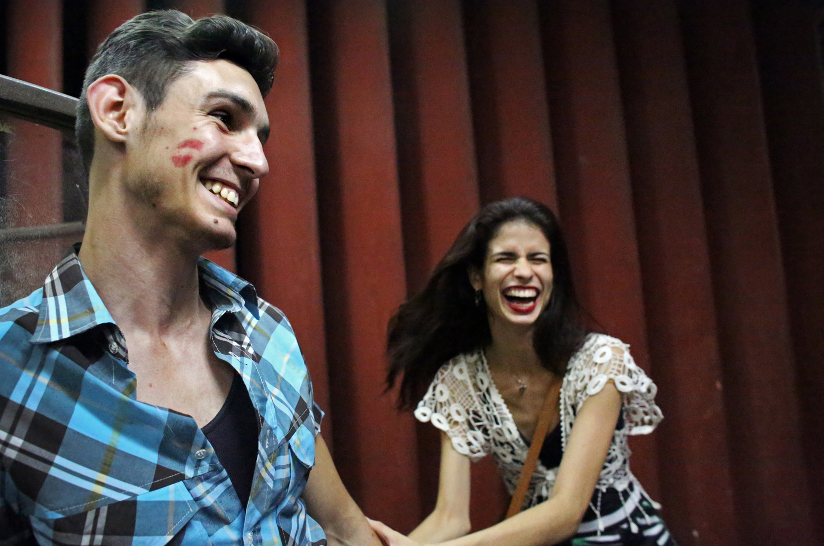 (L-R) Daniel Alemán, 20, a model, and his girlfriend, Kaisa Garcia, 21, a dancer, enjoy each other's company before a Buena Fe concert at Mella theater in Havana, Cuba, on April 16, 2015. Their moments of privacy are rare; like many people their age, they will likely continue to live with their parents for many years before being able to afford living in a place of their own. Garcia wants to remain a dancer but does not think she can, on what she anticipates to be extremely low pay. {quote}If you can forget  about the economy, the safety here is nice,{quote} she says. {quote}I just try to create a bubble in my mind away from anything that doesn't work in the country, and I am happy.{quote}