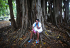 A participant in a march organized by the wives and female relatives of imprisoned political dissidents rests by a tree in Havana, Cuba. The opposition group, Damas de Blanco (Ladies in White,) attends Mass at Santa Rita church each Sunday, then marches around it clad in white, as a symbol of peace. Most complain of regular beatings and detainment - with one of the largest reported (75 of the group's members) in 2011 and 2012. In Catholic countries, Saint Rita is known as the patroness of impossible causes, or heartbroken women.