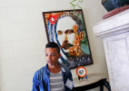 A portrait of José Martí - Cuban poet, journalist, revolutionary philosopher, and political theorist - hangs at a polling station as voters place their ballots in Cuba's Elecciones Parciales (Partial Elections) to elect delegates to the Municipal Assemblies of People's Power, the country's unicameral parliament, on April 19, 2015 in Havana, Cuba. The delegates function as district representatives for a 2.5 year term, communicating complaints and new guidelines between the electorate the Assembly. Voting is not mandatory, but frowned upon if not exercised.
