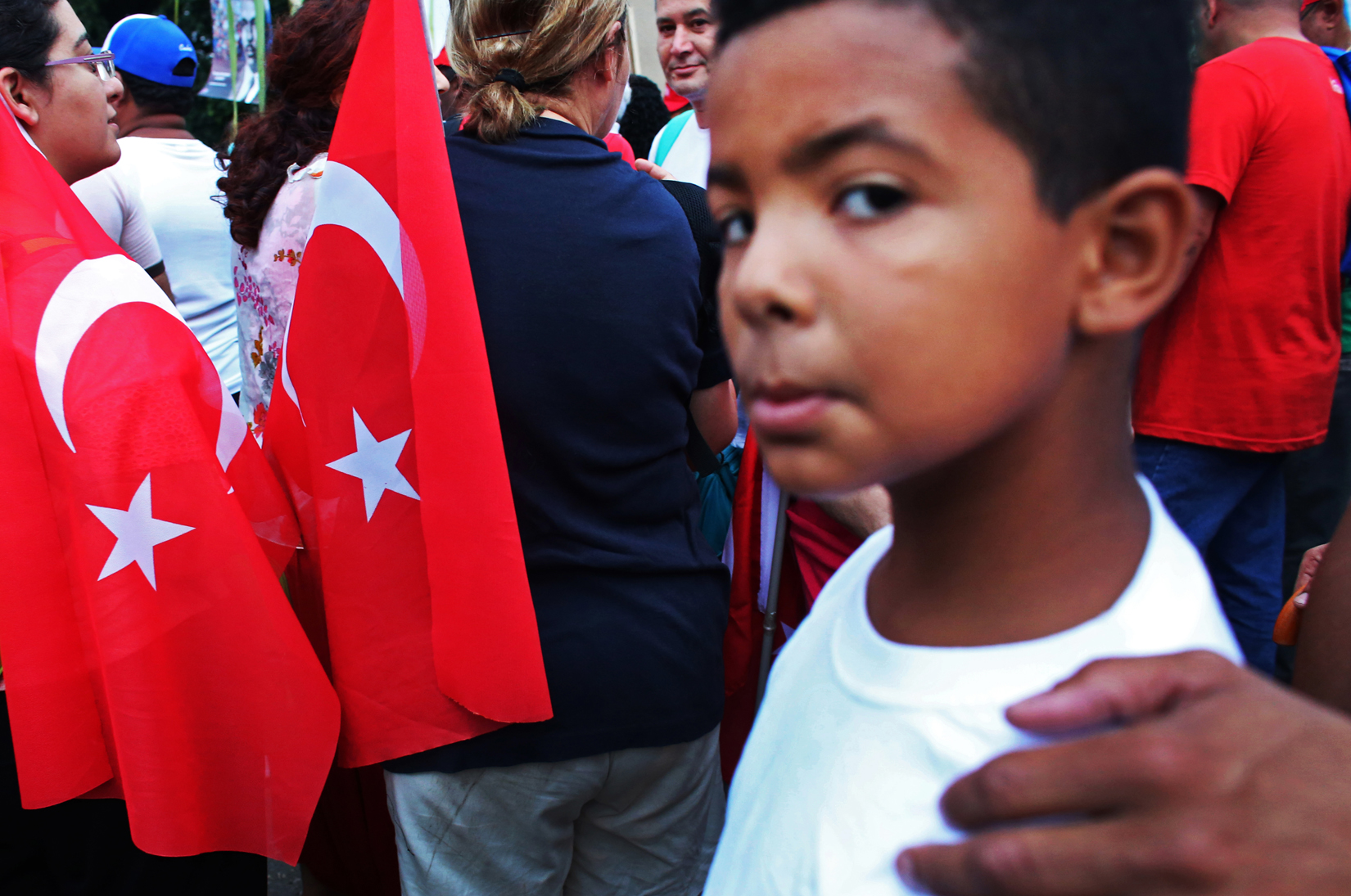 Turkish participants march during the 1st of May Labor Day March in Havana, Cuba, on May 01, 2015. In Cuba, the day known as Día del Trabajo is a call for people to march in the streets in show of support to their local socialist government and the Cuban Revolution. Guests from many countries and social organizations worldwide are known to join the march. Participants have noted that while attendance is not mandatory, absence from the march is usually noticed and discouraged.