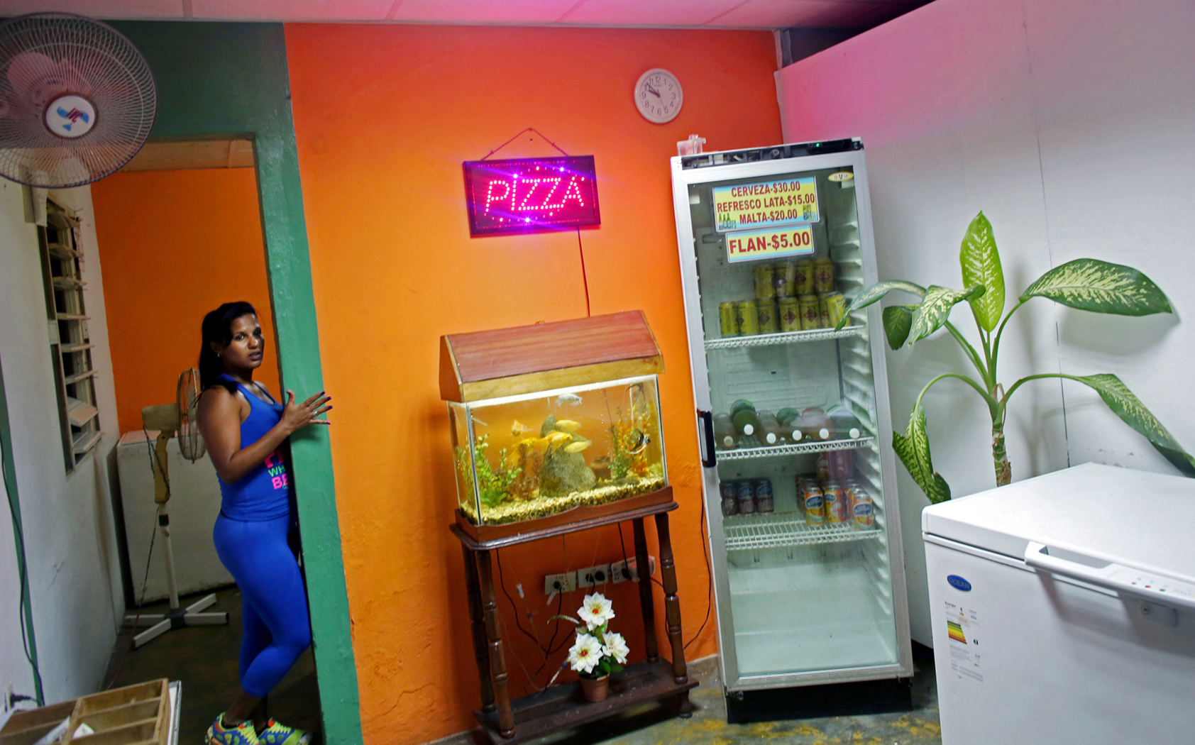 A girl takes orders in a late-night pizza joint, playing mostly American music from the 1980s and 1990s, in the port city of Mariel, Cuba, a town whose tranquil appearance belies its important place in both the history and future of Cuban-American interaction. It is where Russians unloaded nuclear warheads in the 1962 Cuban missile crisis, and the gateway through which 125,000 Miami-bound emigres fled during the Mariel Boatlift of 1980. The town is now the site of construction of a deepwater container port and a free-trade zone, a critical ingredient for which will be the future of the U.S. embargo against Cuba, in place for more than 50 years but now under speculation of being lifted. Cuba, a place of much recent conversation, is a country whose politics and way of life parallel much of my childhood in Bulgaria. This is 2015's continuation to my project on democracy + communism, started last year on the 25th anniversary of the fall of the Berlin Wall - the event that gave opportunity to Eastern Europeans like me to immigrate to the Western world. These are the ways in which Cuba has transported me to pre- and post-1989 Bulgaria.