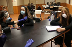 (L-R) EMT instructor Nisha Lewis, and EMT trainees Baila Eisenberger, 37, (also a hair stylist,) Leah Goldberger, 26, (also a pharmacy student,) and Elizabeth Freud, 26, (also a teacher,) take part in an EMT skills training in New York on November 05, 2020. (Photo by: Yana Paskova for The New York Times/the National Geographic Society)