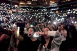 An audience lights up their cell phones instead of lighters, as Sam Smith performs during Jingle Ball at Madison Square Garden in Manhattan, New York on December 12, 2014. The crowd, much like the holiday performance, was energized and sparkling, festive under the glow of reindeer horns, glitter and of course, their cell phones. (For Rolling Stone)