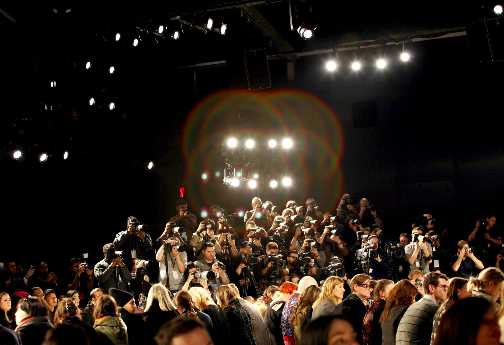 Photographers in the media pit shoot the Creatures of the Wind show at the Lincoln Center in Manhattan, New York, on February 6, 2014, the first day of that season's Mercedes-Benz Fashion Week. (For The New York Times)