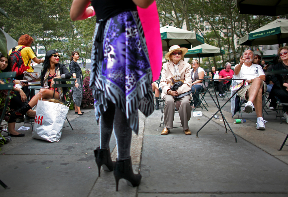 People gape at a high-heeled fashionista outside of the Bryant Park tents on Thursday, September 10, 2009 during the Spring 2010 Mercedes-Benz Fashion Week in Manhattan, New York.