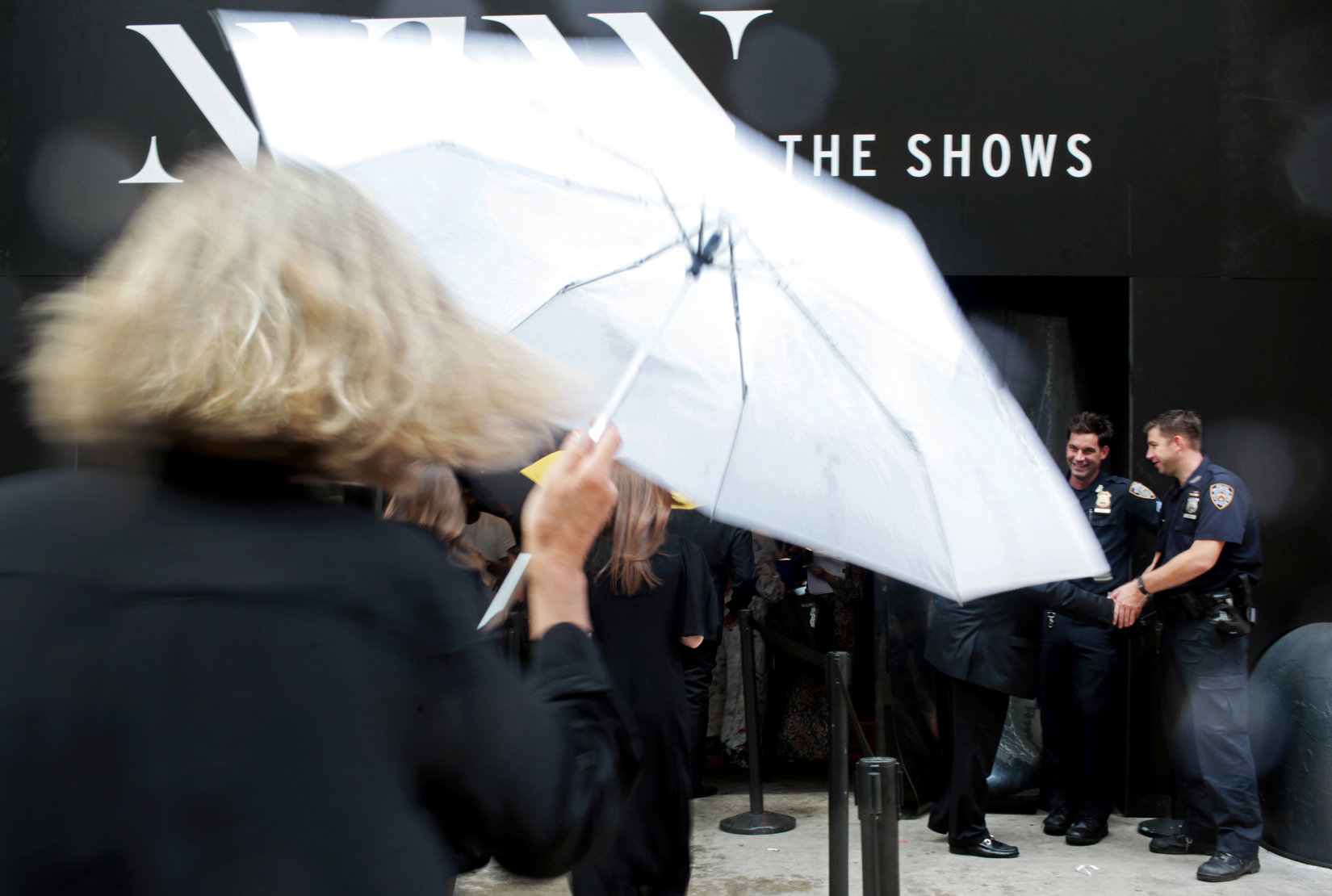 A crowd enters the 360 W. 33rd St. venue on a rainy first day of New York Fashion Week in Manhattan, NY on September 10, 2015.(For The New York Times)